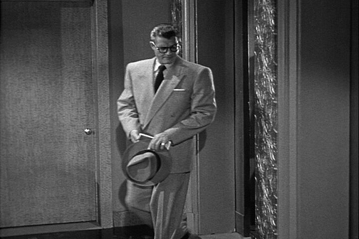 "Clark steps out of the elevator in ""Shot In The Dark."""