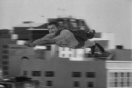 George Reeves soars through the air.