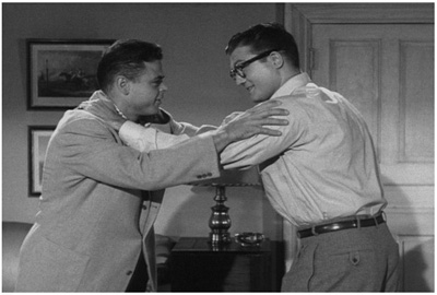 Clark Kent (George Reeves) teaches Wayne the ability to hold off the
