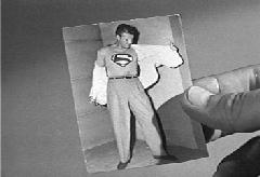 Alan's photograph of Clark changing to Superman.
